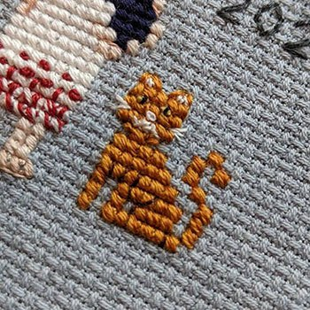Cute little tabby cat in cross-stitch form